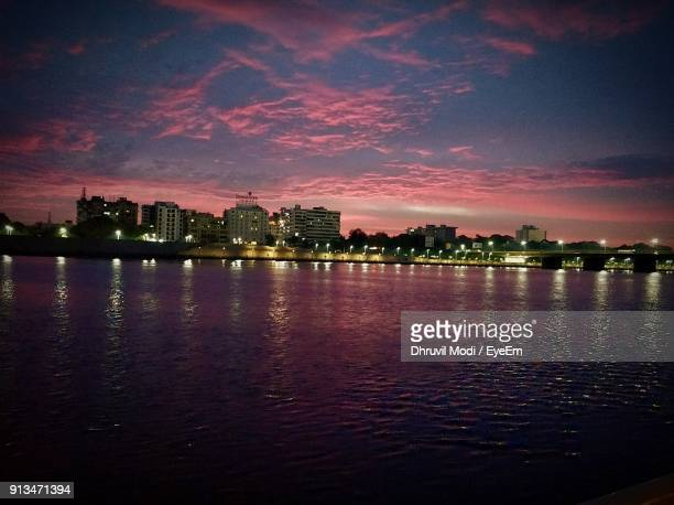 city at waterfront during sunset - ahmedabad stock pictures, royalty-free photos & images