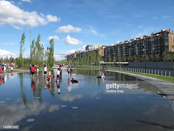 City Beach in Madrid Rio it is formed by three ovalshaped water areas with different effects such as smooth stretch of water jets of varying heights...