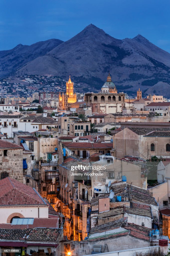City below mountains at dusk, Palermo, Sicily, Italy : Stock Photo