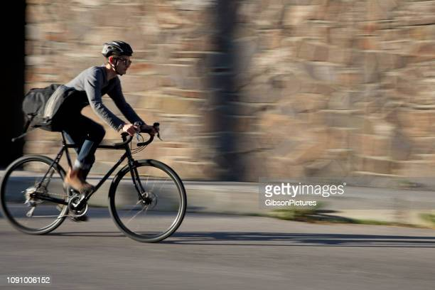 city bicycle messenger - cycling helmet stock pictures, royalty-free photos & images