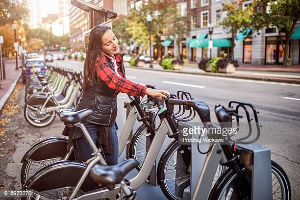city bikes for hire - bicycle parking station stock photos and pictures