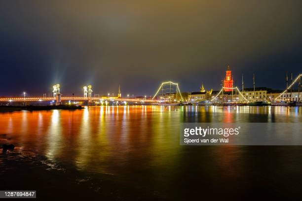 City Bridge and New tower illuminated in orange color for International Day for the Elimination of Violence against Women on November 25 in Kampen,...