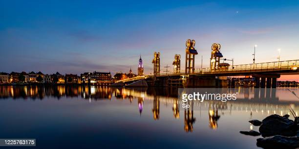 "city bridge over the river ijssel in kampen after sunset during a beautiful springtime evening. - ""sjoerd van der wal"" or ""sjo"" stock pictures, royalty-free photos & images"
