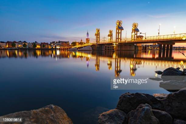 "city bridge over the river ijssel in kampen after sunset during a beautiful springtime evening - ""sjoerd van der wal"" or ""sjo"" stock pictures, royalty-free photos & images"