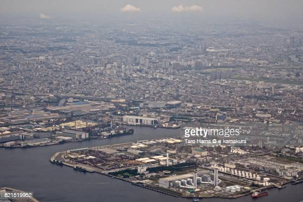 City building and factory area in Kawasaki city in Kanagawa prefecture daytime aerial view from airplane