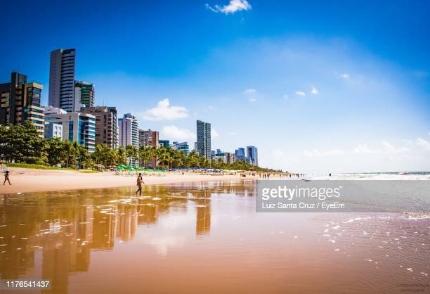 city buildings by sea against sky - recife stock pictures, royalty-free photos & images