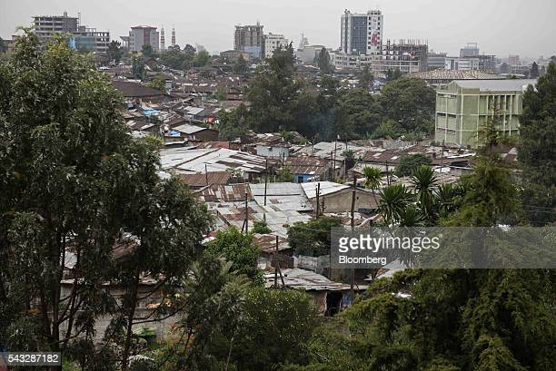 City buildings stand on the city skyline beyond corrugated iron shacks in Addis Ababa Ethiopia on Saturday June 25 2016 Kenya and Ethiopia have...