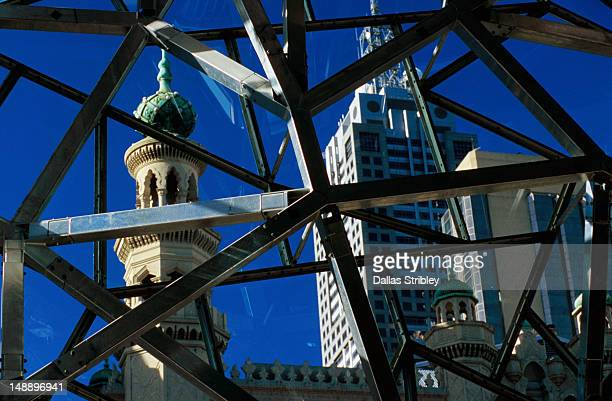 City buildings through glass roof of Federation Square.