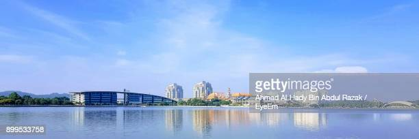 city by river against blue sky - putrajaya stock pictures, royalty-free photos & images