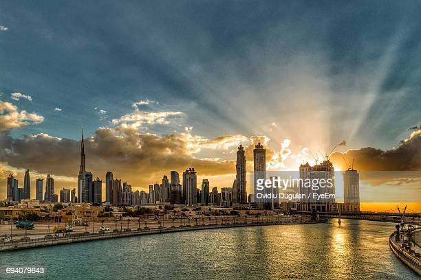 city by river against sky - morning stock pictures, royalty-free photos & images