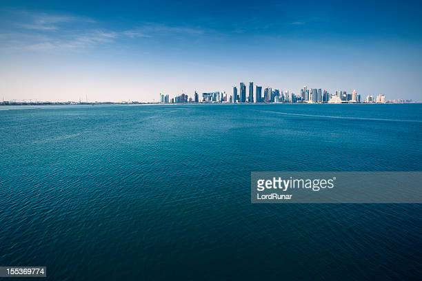 city by the sea - qatar stock pictures, royalty-free photos & images