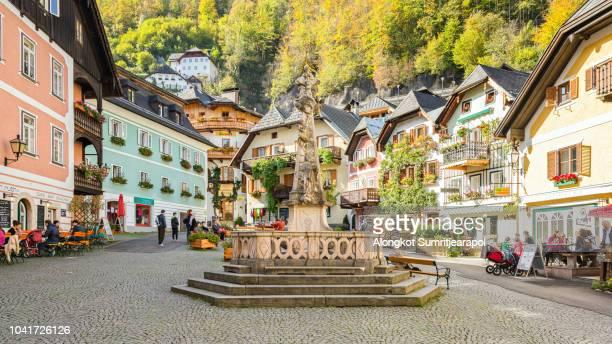 city center of hallstatt village in alps at austria - hallstatt stock-fotos und bilder