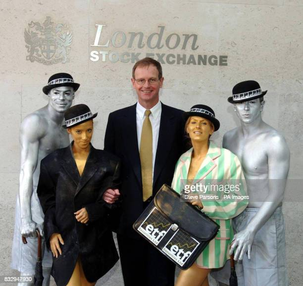 City characters covered in body paint with ETF Securities chairman Graham Tuckwell outside the London Stock Exchange London to mark the launch of an...