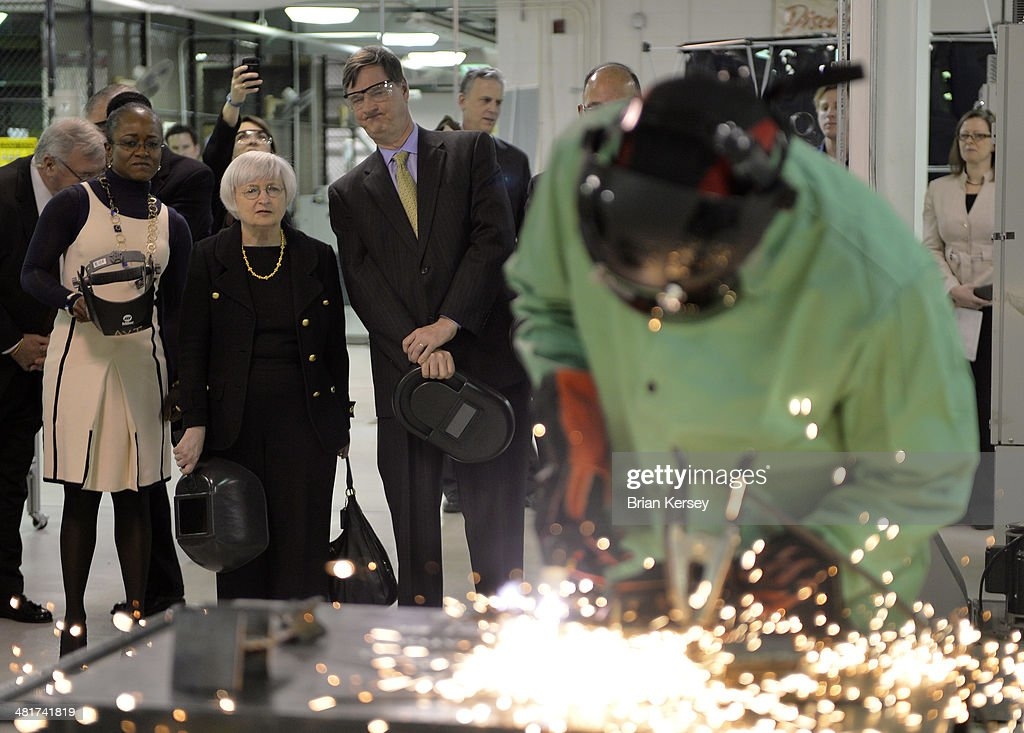 City Colleges of Chicago Chancellor Cheryl Hyman (L-R), Federal Reserve Chair Janet Yellen and Federal Reserve Bank of Chicago Chairman and CEO Charles Evans watch as student Shaylo Davis cuts metal as they tour the College to Careers Program in Advanced Manufacturing at the City Colleges of Chicago's Daley College on March 31, 2014 in Chicago, Illinois. In earlier remarks Yellen indicated that the economy was far from healthy and that the Fed would continue its policy of maintaining low interest rates.