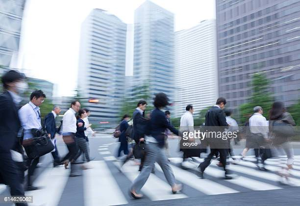 City Commuters Crosing the Road in Tokyo