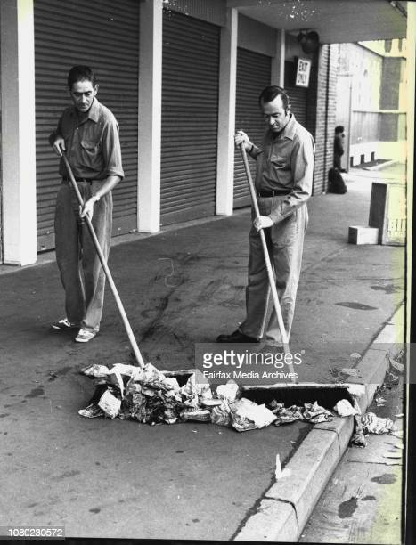 City Council Cleansing staff members, Ted Seckold and Herb Ainsworth, seep up mountains of litter outside the main entrance of the Showground today....