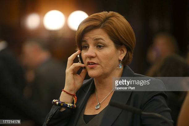 City Council member Christine Quinn speaks on the phone after voting with other members on whether to bring a motion to the floor to override Mayor...