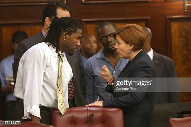 City Council member Christine Quinn speaks with fellow member Jumaane Williams before voting on whether to bring a motion to the floor to override...