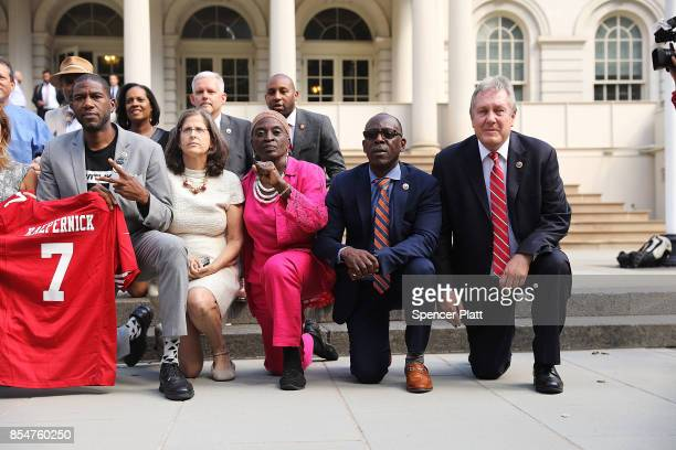 City Council Members 'take a knee' on the steps of City Hall in reaction to President Donald Trump's condemnation of NFL players who do the same on...