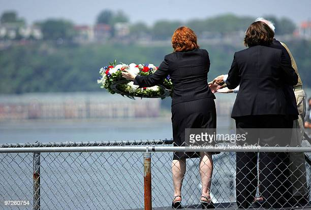 City Council Speaker Christine Quinn and her partner Kim Catullo are joined by their fathers Lawrence Quinn and Anthony Catullo as they toss a wreath...
