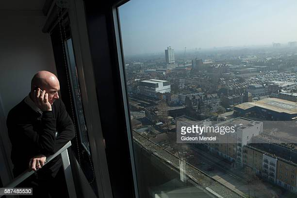 A city councillor from the Hertfordshire County Council looks down at the view of Newham from the Olympic Site Viewing Gallery at Holden Point in...