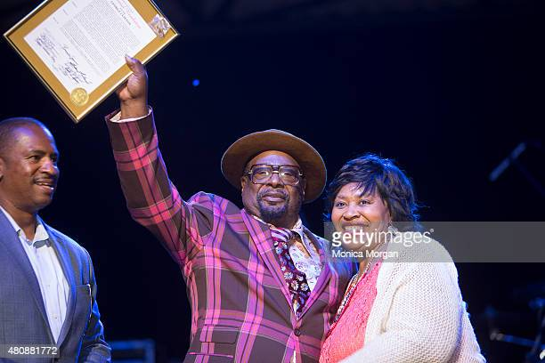 City Councilman Scott Benson and City Council President Brenda Jones present Musician George Clinton with an award at Chene Park on July 10 2015 in...