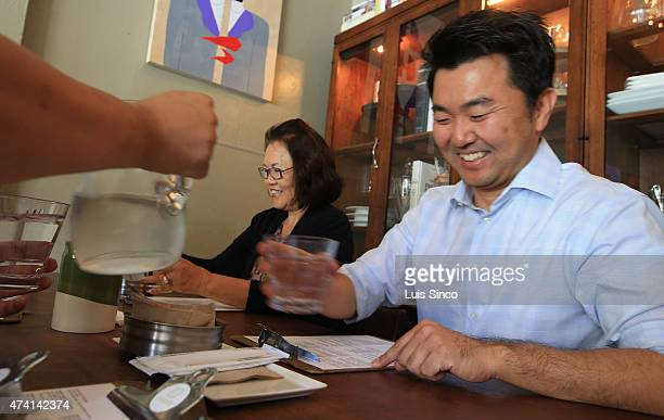 City Councilman-elect David Ryu celebrates his election victory with his mother Michelle Ryu at Epicurean Umbrella in Los Feliz on Wednesday, May 20,...