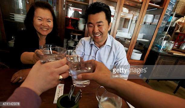 City Councilman-elect David Ryu celebrates his election victory with his mother Michelle Ryu, left, and staff members Rachel Estrada and Andrew Jiang...