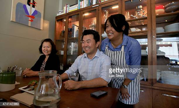 City Councilman-elect David Ryu celebrates his election victory with his mother Michelle Ryu, left, and restaurant owner Jennyfer Rodgers at...