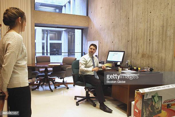 City Councilor Josh Zakim spoke with deputy chief of staff Kyndal Henicke left in his offices at Boston City Hall Wednesday January 15 2014 His...
