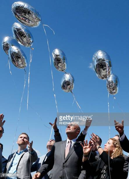 City county and state officials release balloons in honor of the victims during a prayer vigil for the Marjory Stoneman Douglas High School shooting...