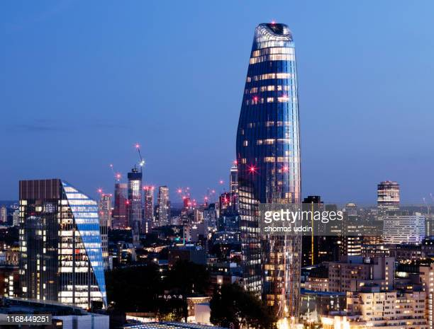 city developments at dusk - elevated view - continuous stock pictures, royalty-free photos & images