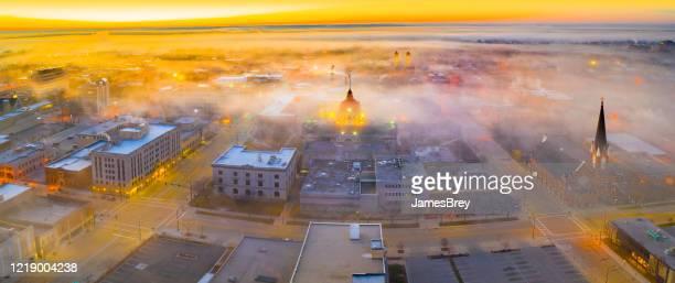 city downtown under scenic spring fog at sunrise. - green bay wisconsin imagens e fotografias de stock