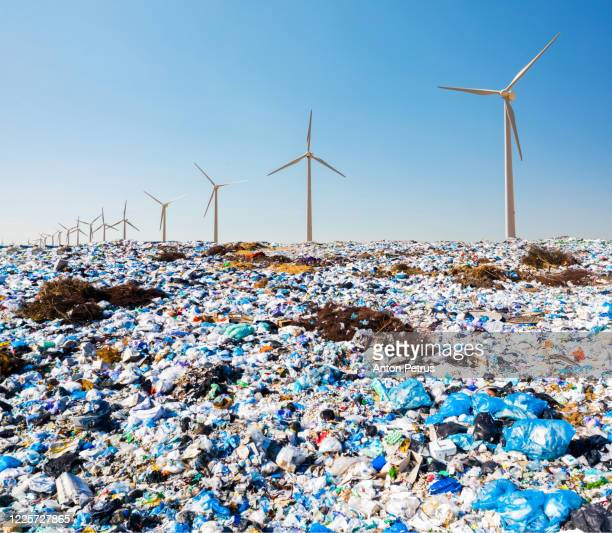 city dump on the background of wind generators. the concept of recycling garbage and green energy - プラスチック汚染 ストックフォトと画像