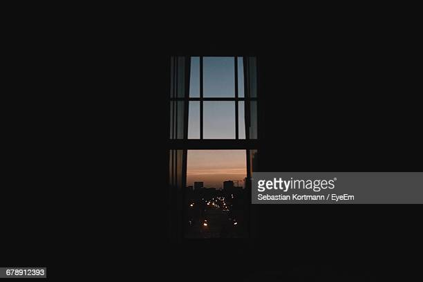 City During Sunset Seen Through Window