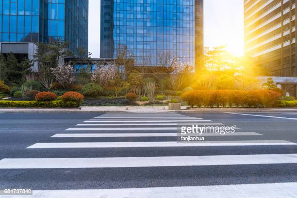 city empty road,asphalt road through modern city - zebra crossing stock pictures, royalty-free photos & images