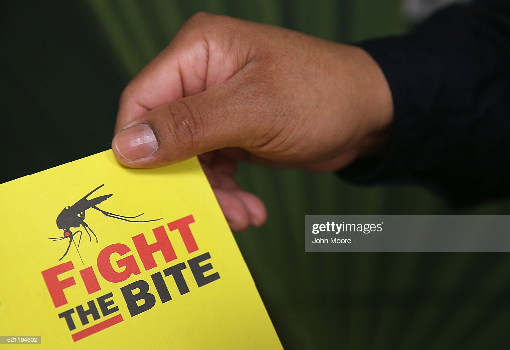 A city environmental health worker displays literature to be distrubuted to the public on April 14, 2016 in McAllen, Texas. Health departments, especially in areas along the Texas-Mexico border, are preparing for the expected arrival of the Zika Virus, carried by the aegypti mosquito, which is endemic to the region. The U.S. Centers for Disease Control (CDC), announced this week that Zika is the definitive cause of birth defects seen in Brazil and other countries affected by the outbreak.