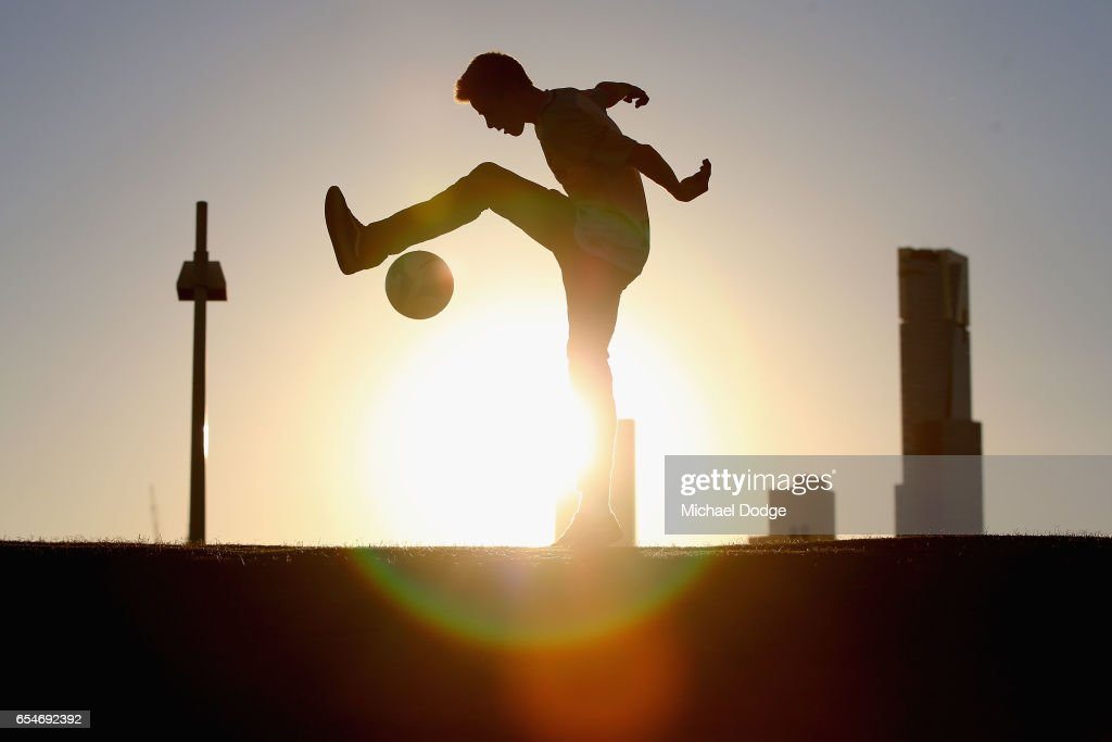 A City fan plays with a soccer ball before the round 23 A-League match between Melbourne City FC and the Newcastle Jets at AAMI Park on March 18, 2017 in Melbourne, Australia.