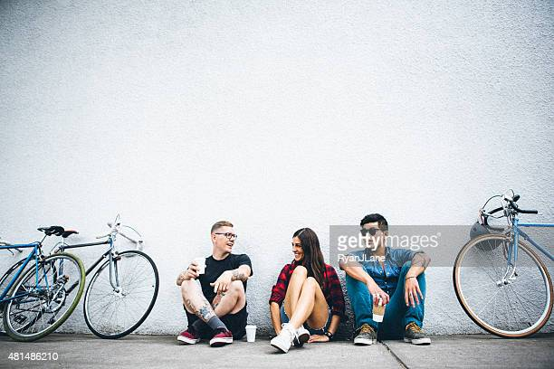 city friends with bikes and coffee - city life stock pictures, royalty-free photos & images