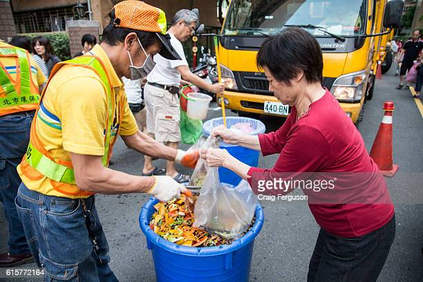 A city garbageman helps a resident dispose of food waste in specially prepared bins Food waste is typically sorted into categories and is either used...