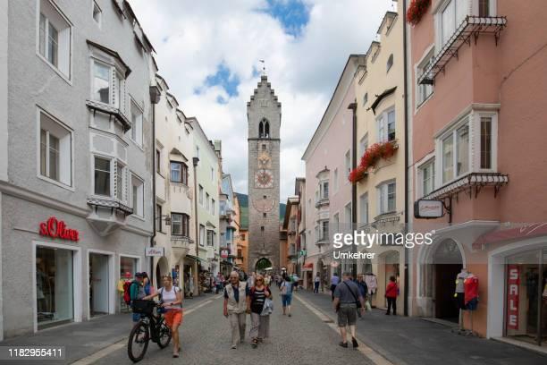 city gate in sterzing - umkehrer stock-fotos und bilder