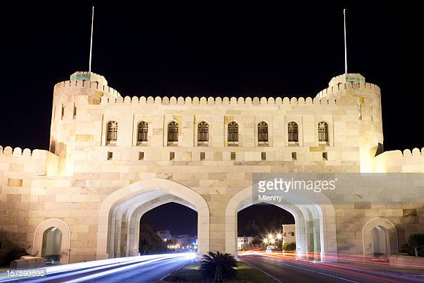 city gate masqat with car light trails at night oman - muscat governorate stock pictures, royalty-free photos & images