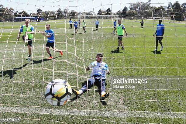 City goalkeeper Dean Bouzanis fails to stop a goal from Luke Brattan during a Melbourne City ALeague training session on October 16 2017 in Melbourne...