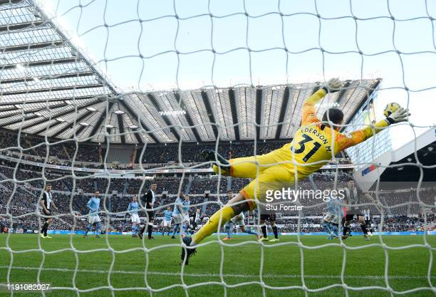 City goalkeeper Edderson dives in vain as a shot from Newcastle player Jonjo Shelvey sails into the net for the 2nd Newcastle goal during the Premier...