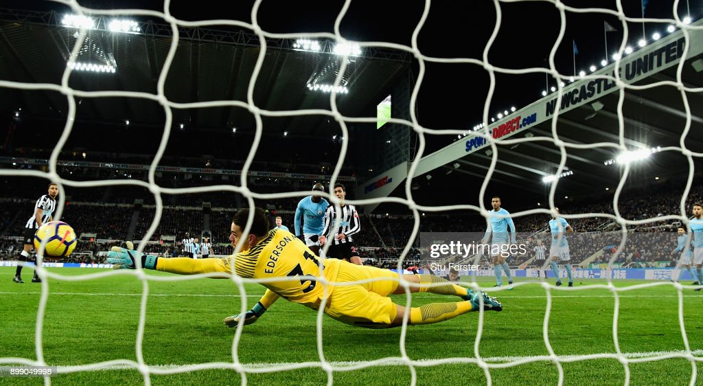 City goalkeeper Ederson dives as a header from Dwight Gayle goes narrowly wide during the Premier League match between Newcastle United and Manchester City at St James' Park on December 27, 2017 in Newcastle Upon Tyne, England.