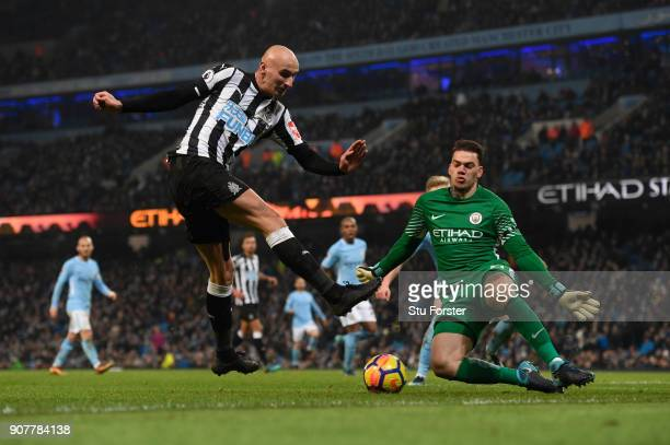 City goalkeeper Ederson saves from Jonjo Shelvey of Newcastle during the Premier League match between Manchester City and Newcastle United at Etihad...
