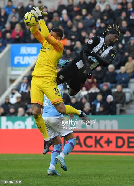City goalkeeper Ederson wins the ball despite the challenge of Newcastle winger Allan Saint-Maximin during the Premier League match between Newcastle...