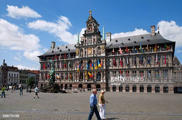 City hall and fountain statue of Silvius Brabo throwing the giant's hand at the Grote markt / Town Square Antwerp Belgium