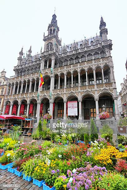 city hall and official building with a lot of flower s in big square of brussels located grand place in Belgium