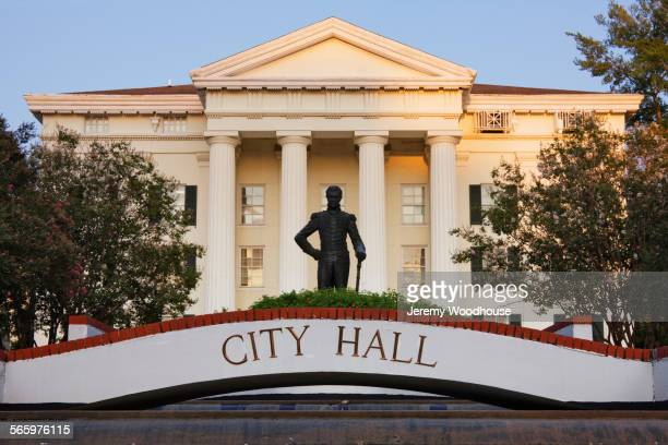 city hall facade and statue, jackson, mississippi, united states - town hall stock pictures, royalty-free photos & images